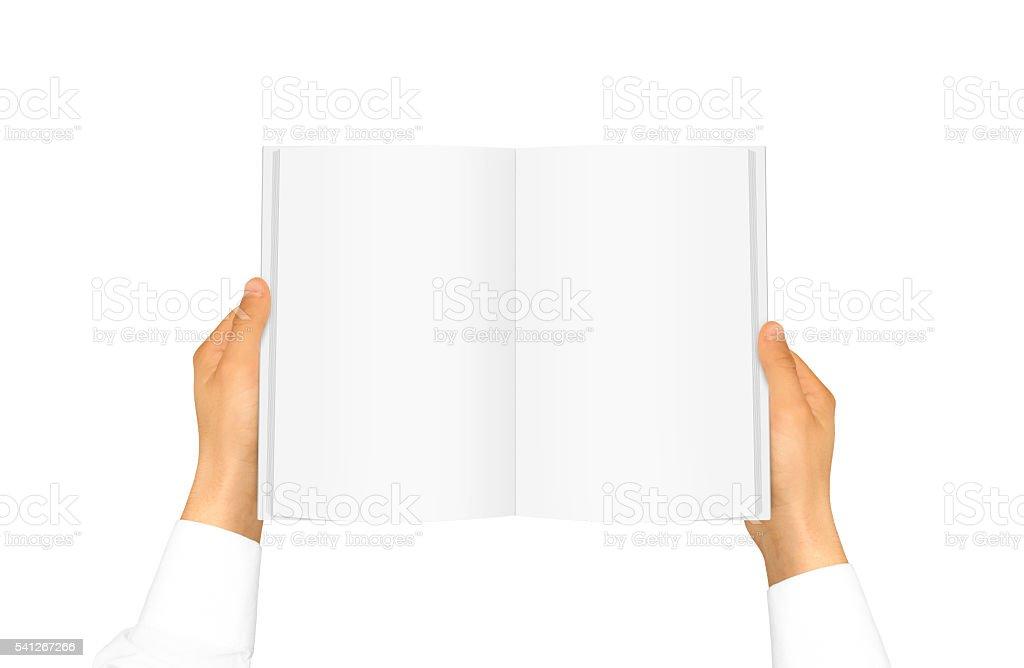 Hand white shirt sleeve holding book stock photo