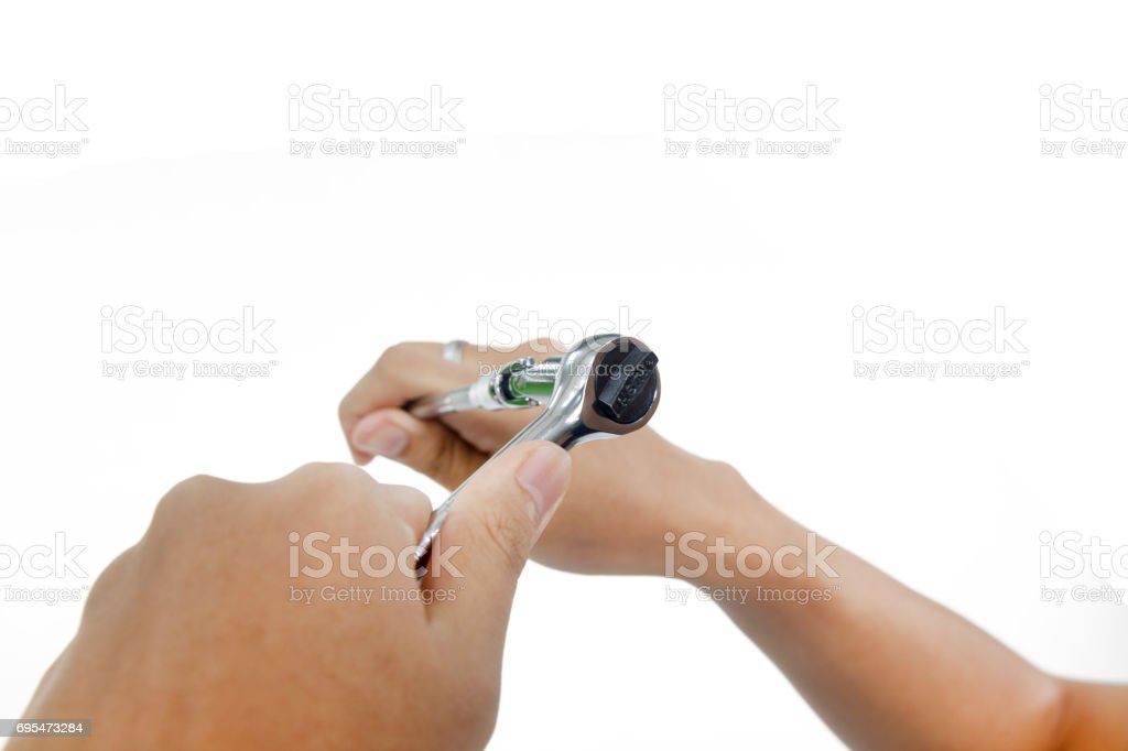 hand wiht Ratchet spanner stock photo