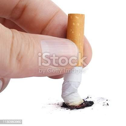 istock Hand with a cigarette butt 1130980960