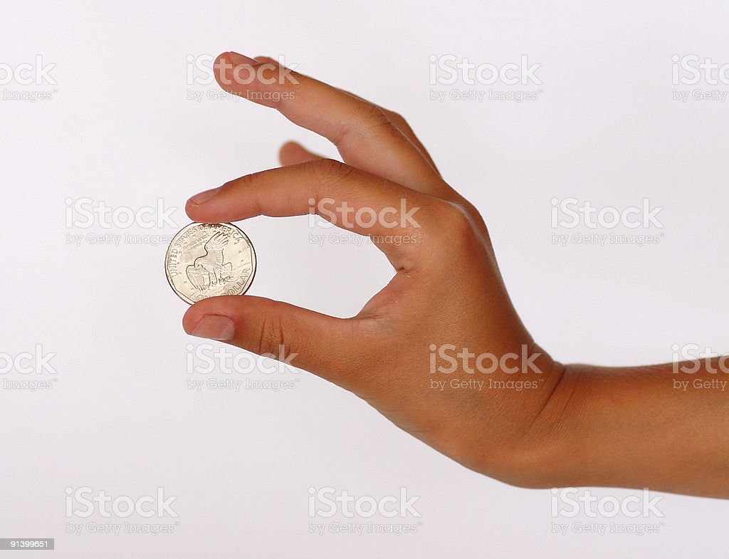 Hand with a coin royalty-free stock photo