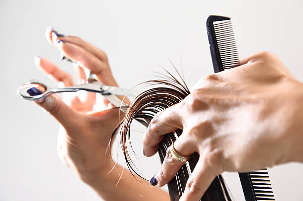 hand with a comb cutting hair of woman - hairstyle stock photos and pictures