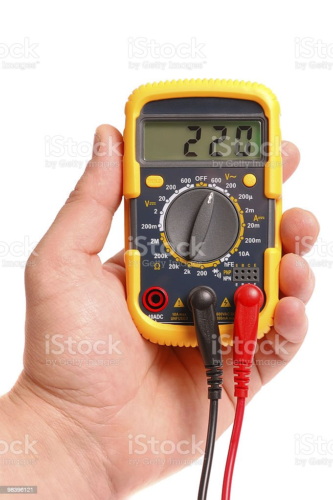 Hand with a digital multimeter on  white background royalty-free stock photo