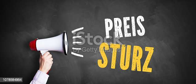 istock hand with a megaphone in front of a blackboard with the message