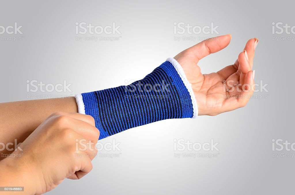 hand with a orthopedic wrist brace stock photo