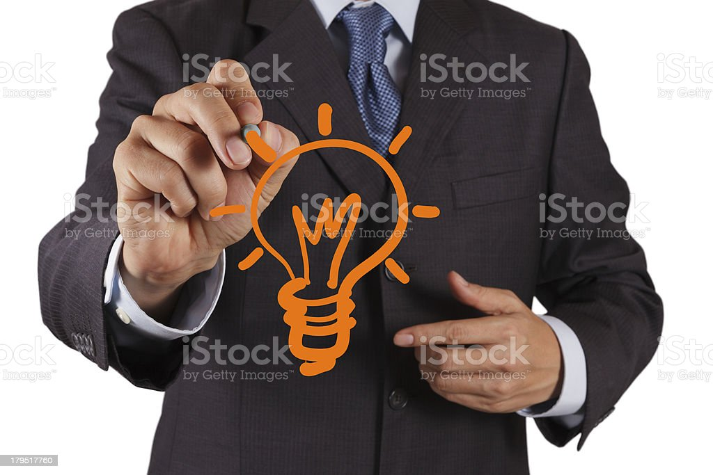 hand with a pen drawing light bulb royalty-free stock photo