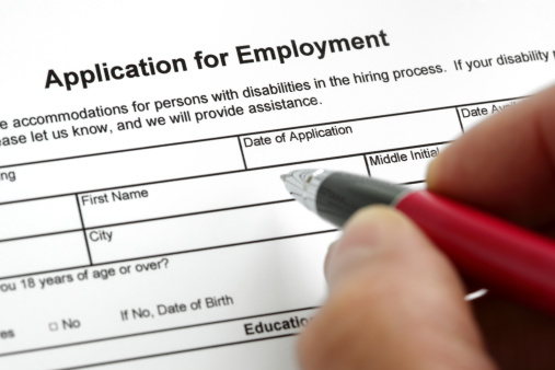 Completing a job application form with focus on heading