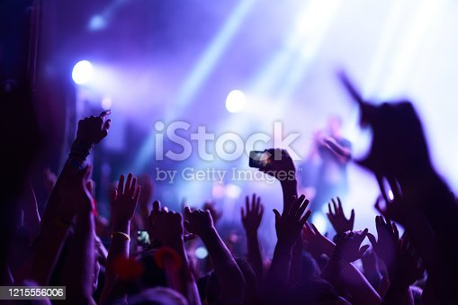 833314292 istock photo Hand with a phone records live music festival. 1215556006
