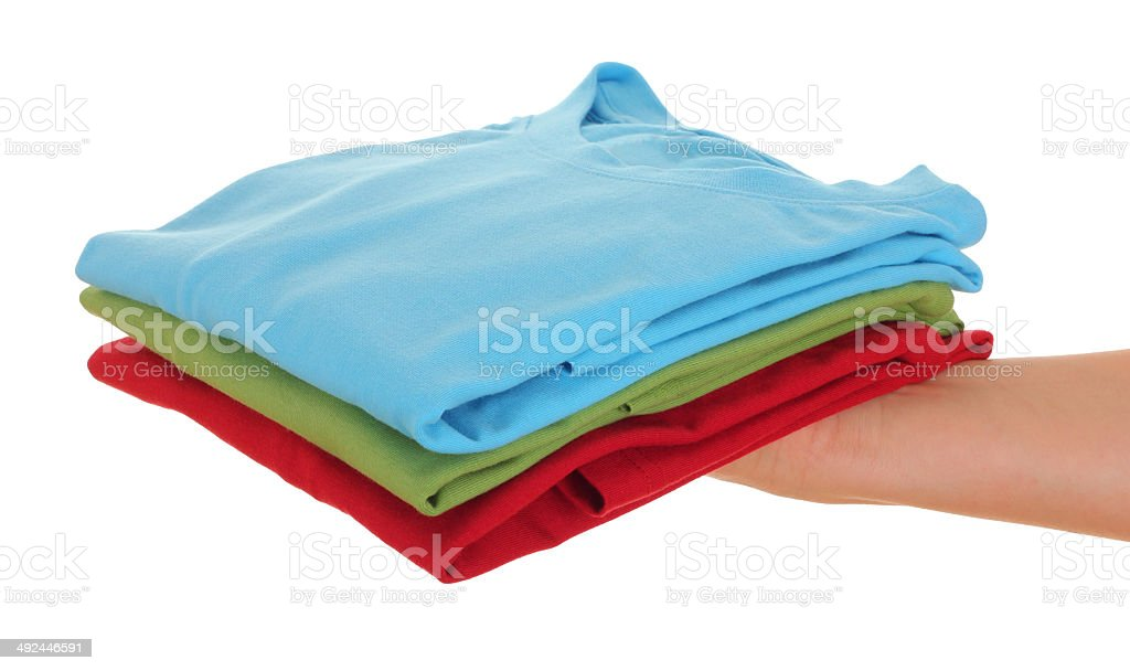 hand with a pile of clean clothes stock photo