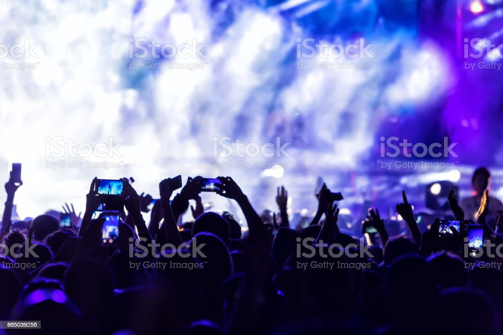 Hand with a smartphone records live music festival royalty-free stock photo