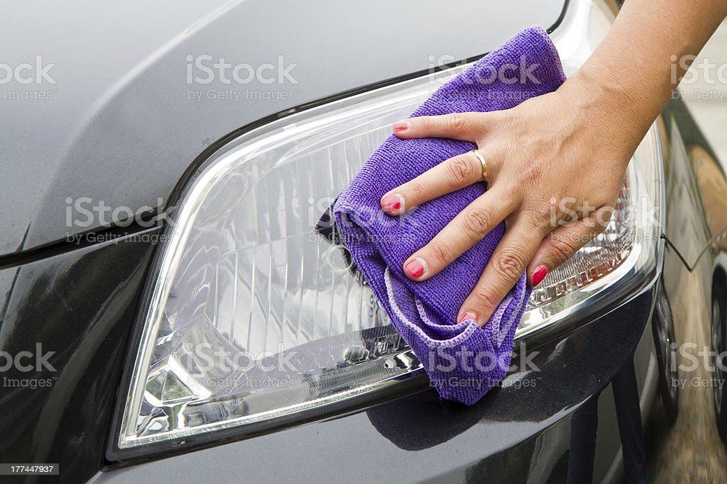 Hand with a wipe the car polishing royalty-free stock photo