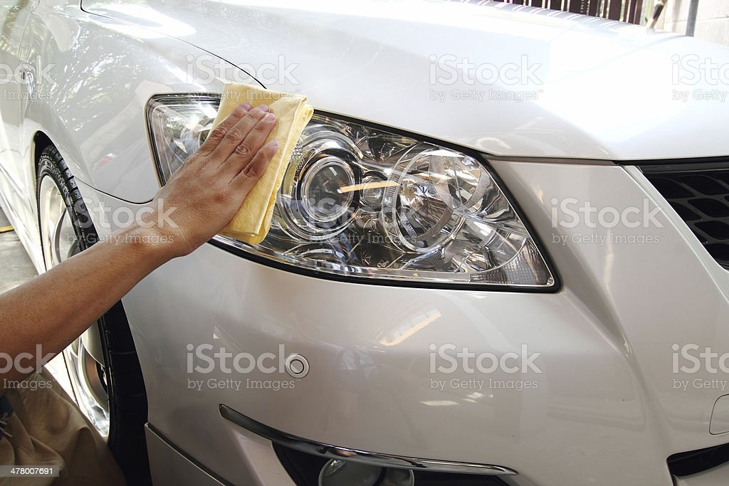 Hand with a wipe the car polishing stock photo