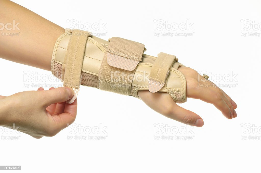 hand with a wrist brace stock photo