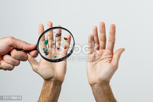 istock Hand with allergic reaction and magnifier 1211766315