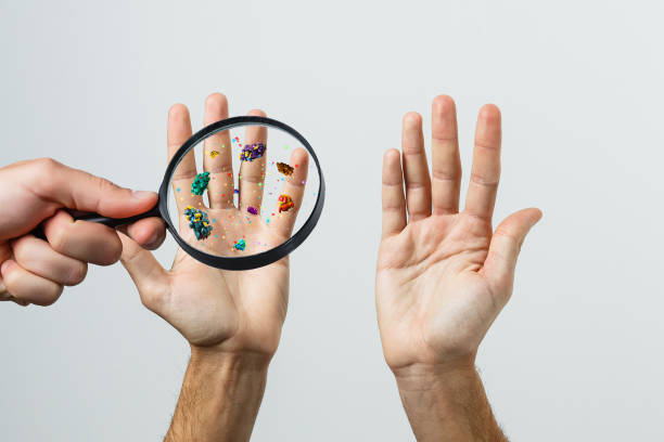 Hand with allergic reaction and magnifier Hand with allergic reaction and magnifier pathogen stock pictures, royalty-free photos & images