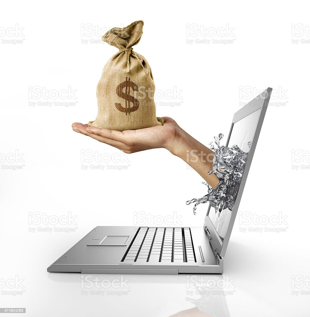 Hand with bag of US Dollars coming out from computer stock photo