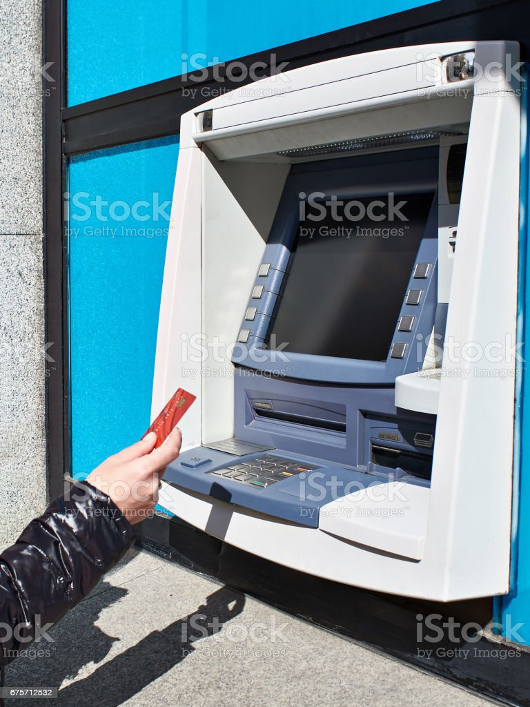Hand with bank card at ATM 免版稅 stock photo