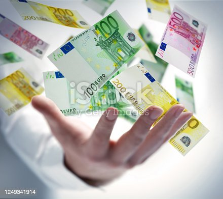 Male hand with flying 100 Euro notes