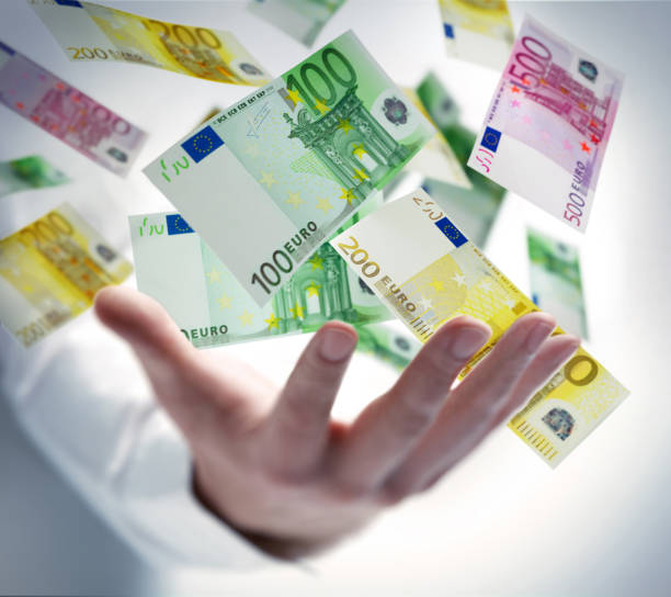Hand with banknotes stock photo