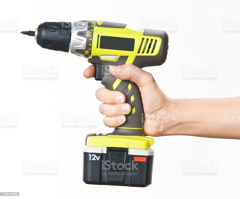 hand with battery screwdriver stock photo