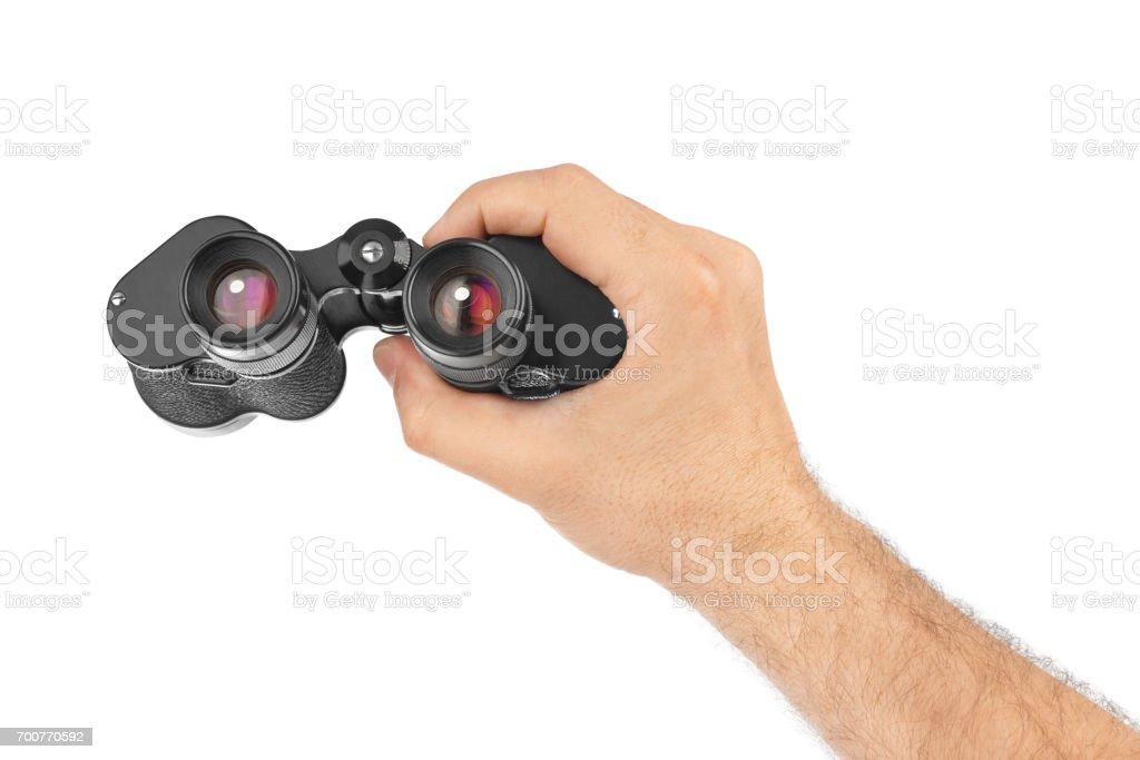 Hand with binoculars stock photo