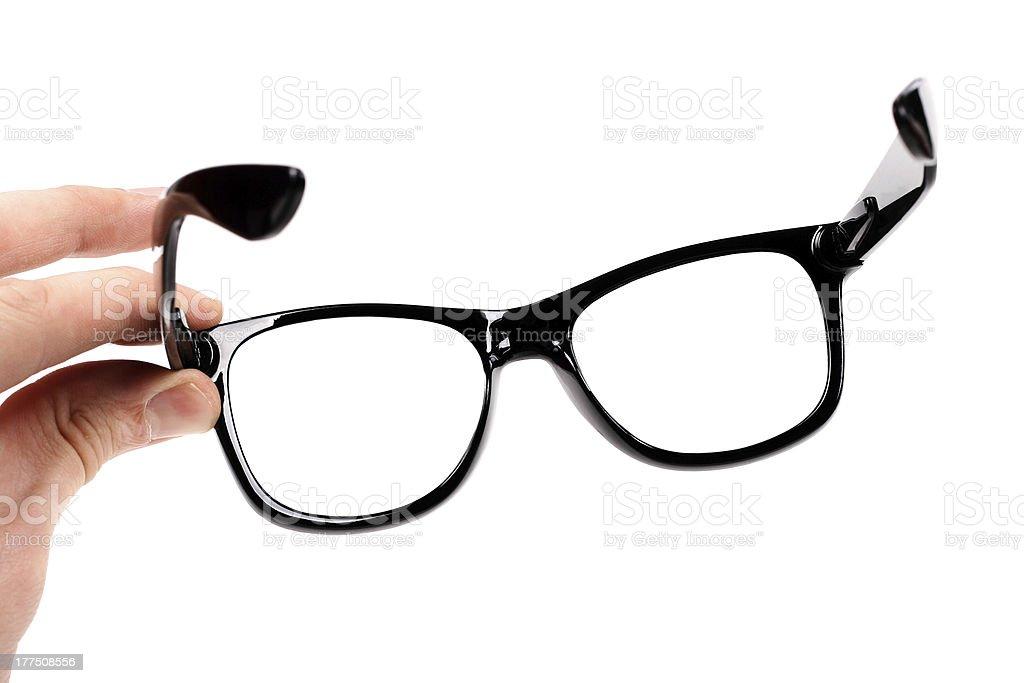 hand mit schwarzen Gläsern – Foto