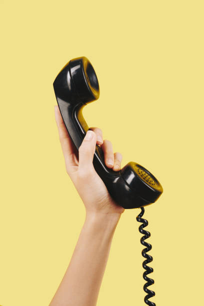 Hand with black telephone receiver stock photo