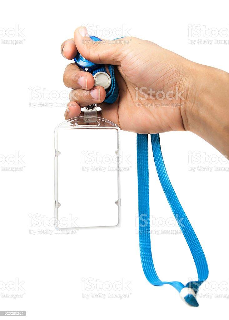 Hand with Blank ID card  / badge stock photo