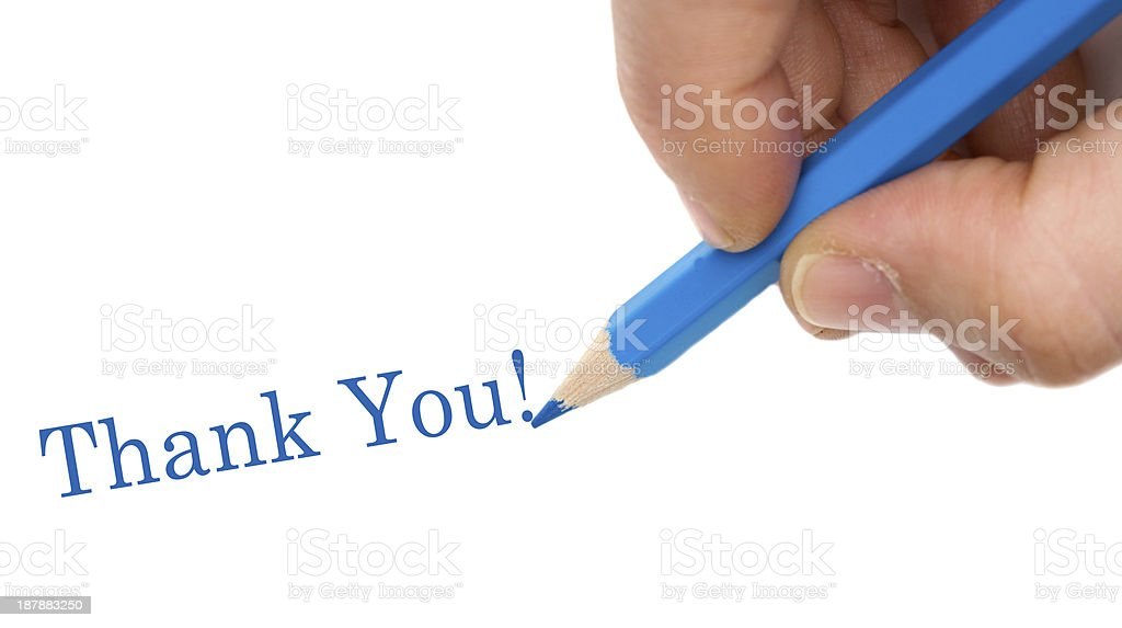 Hand with blue pen writing Thank You royalty-free stock photo