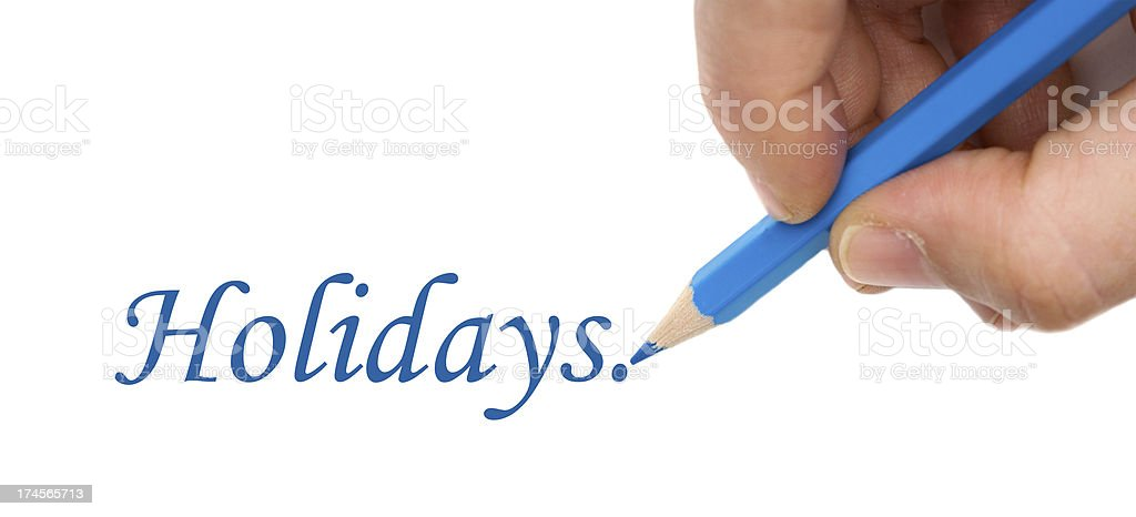 Hand with blue pen writting the word 'Holidays' royalty-free stock photo