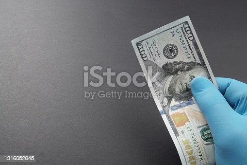 Series of American 100 US dollar concept: money banknotes on black background. Selective focus on one hundred USD. US paper currency on exchange and stock markets. Finance and economy.