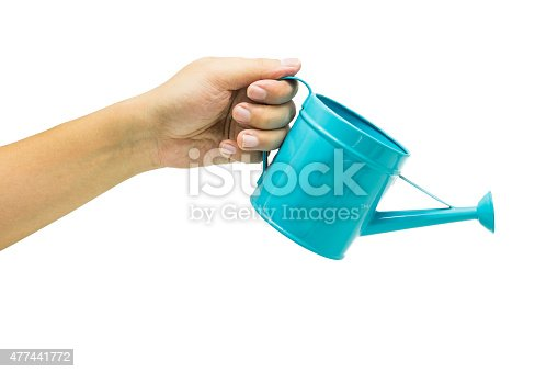 istock hand with blue watering can isolated on white background 477441772