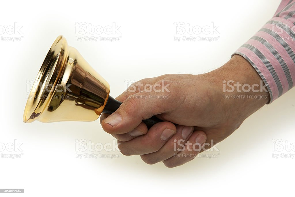 Hand  with brass bell stock photo