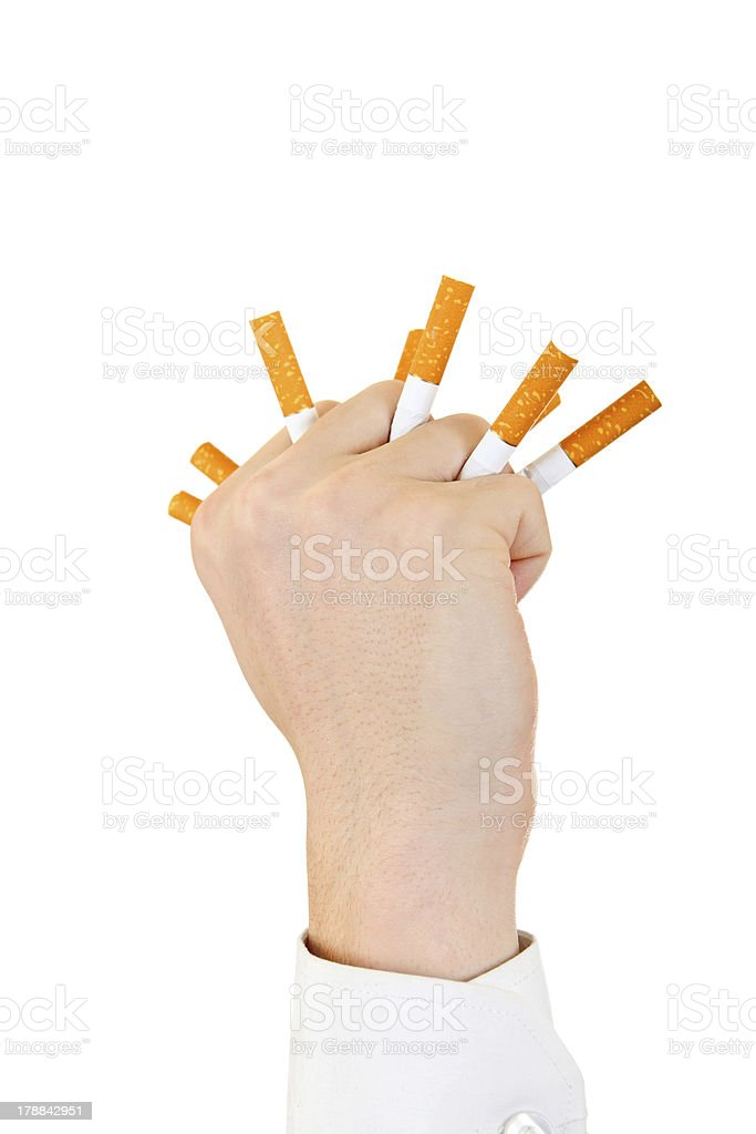 Hand With Broken Cigarettes royalty-free stock photo