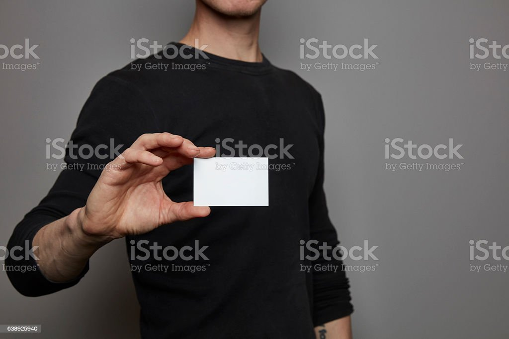 Hand with business card / sign holder stock photo