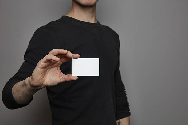 Hand with business card / sign holder – Foto