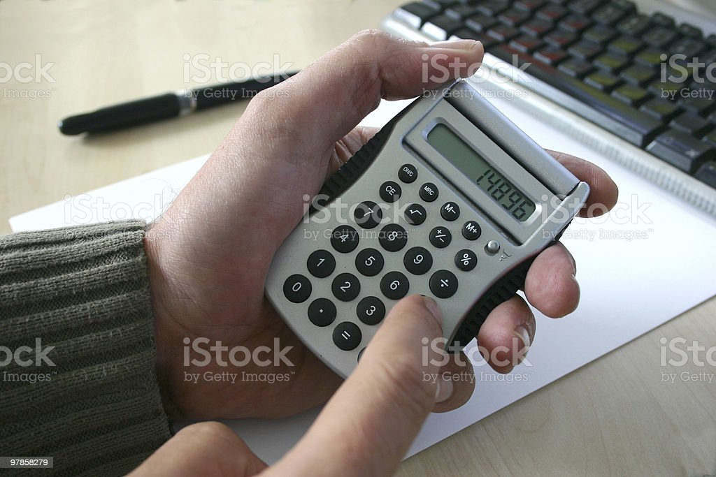 Hand with calculator royalty-free stock photo