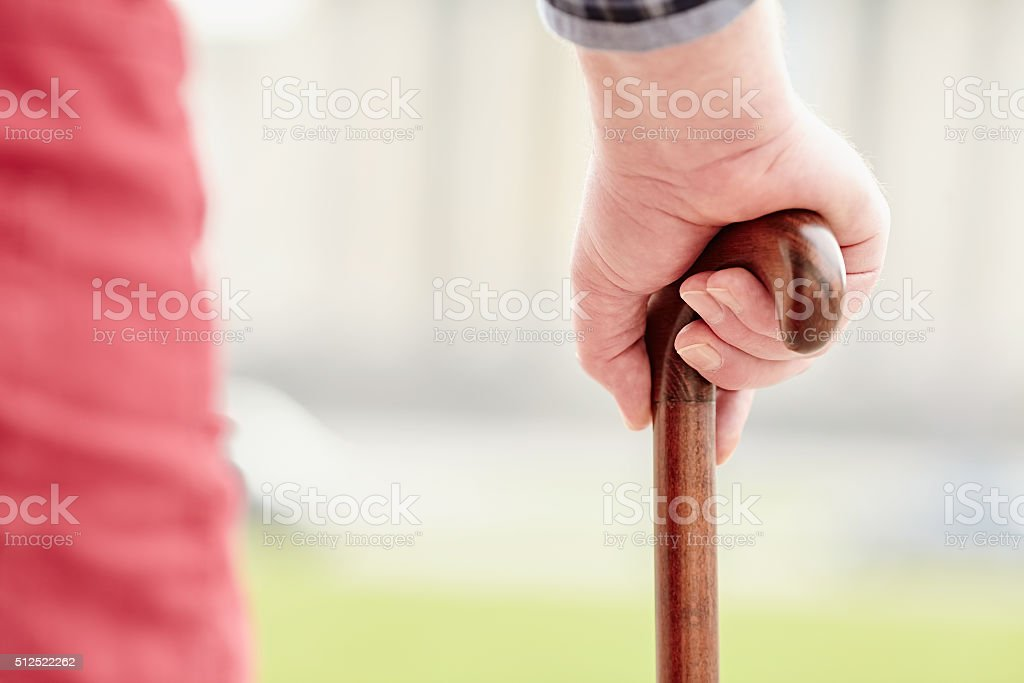 Hand with cane closeup stock photo