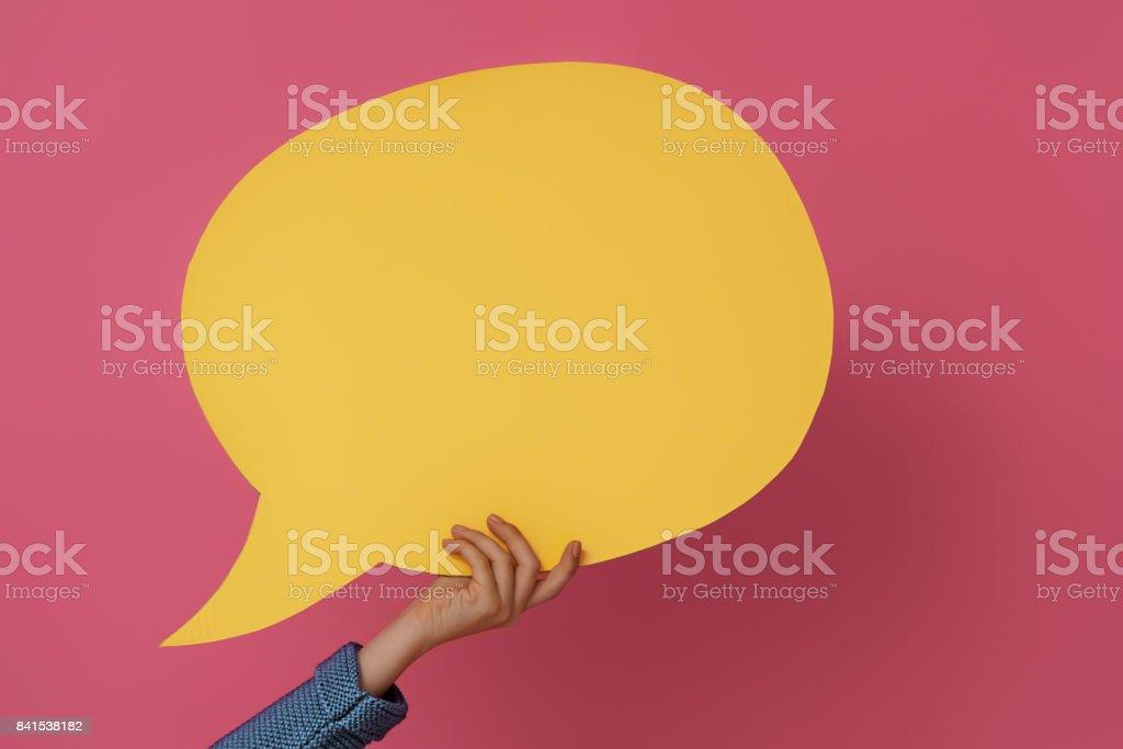 Mão com o discurso dos desenhos animados - foto de acervo