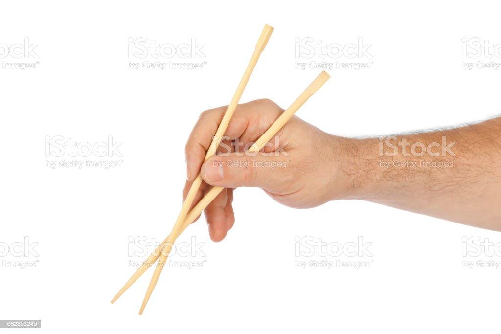 Hand with chopsticks royalty free stockfoto