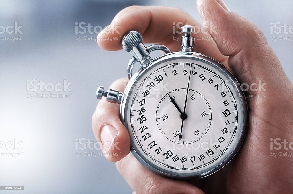 Hand with classic stopwatch stock photo