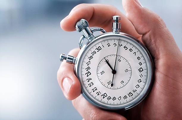 hand with classic stopwatch - stopwatch stockfoto's en -beelden
