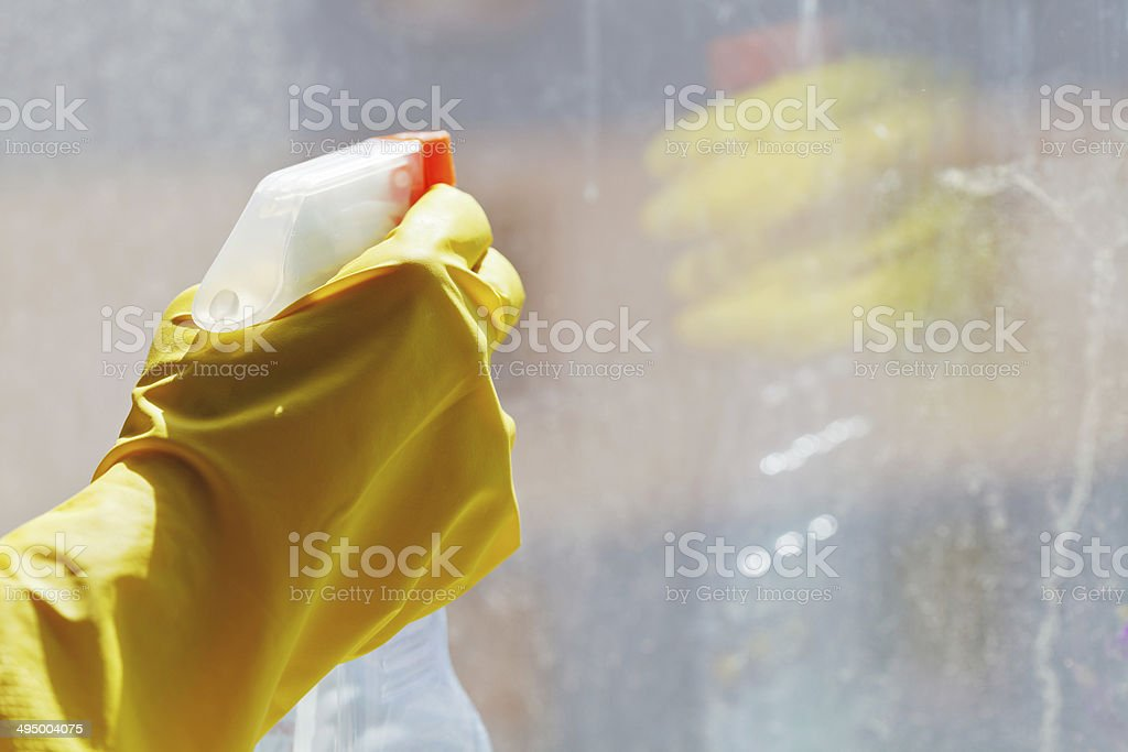 hand with cleaner spray bottle royalty-free stock photo