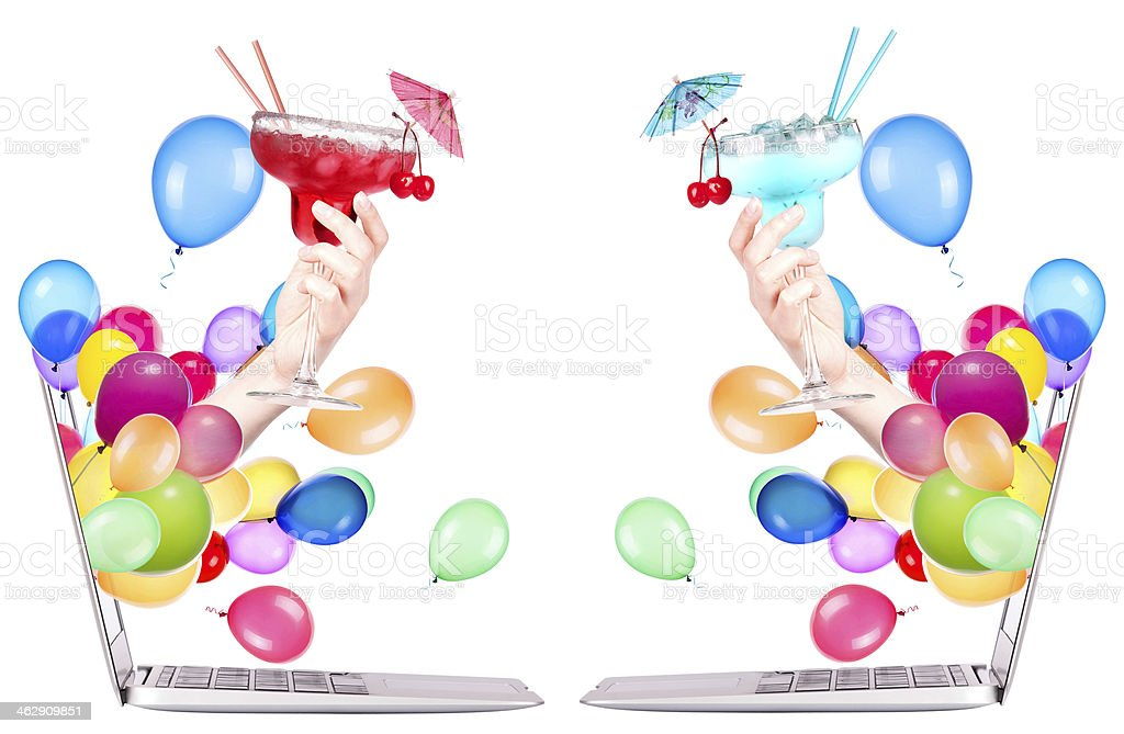 hand with cocktailand laptop stock photo