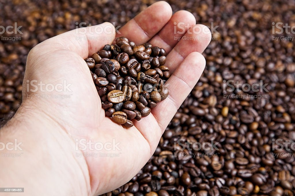 hand with coffee beans royalty-free stock photo