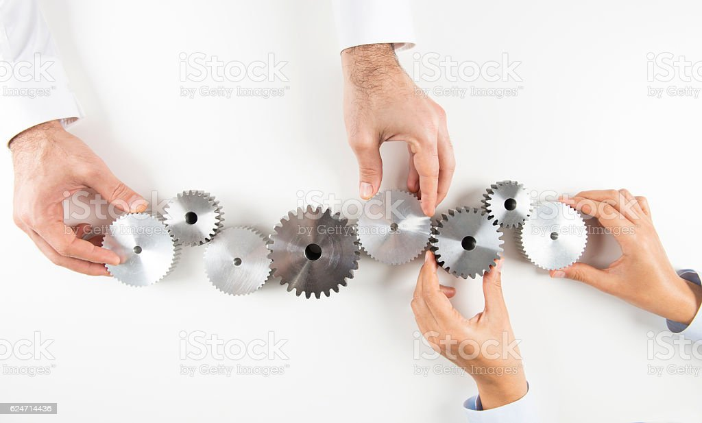 Hand With Cogs stock photo