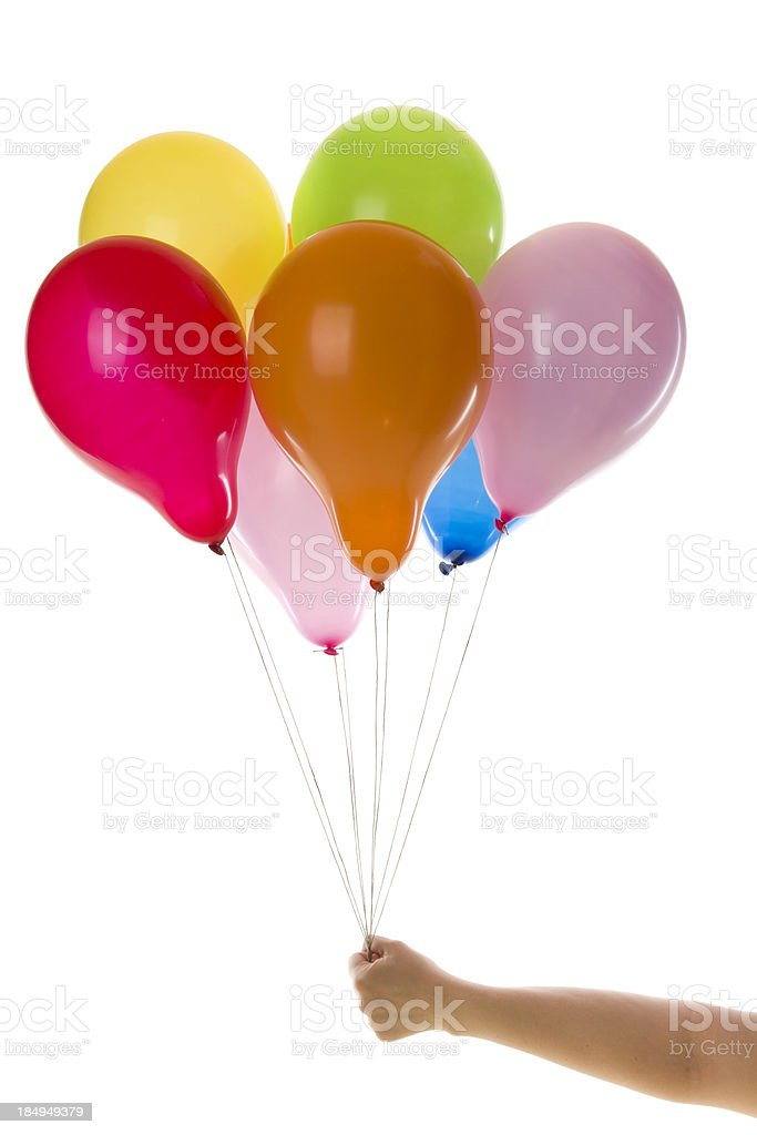 hand with colorful balloons stock photo