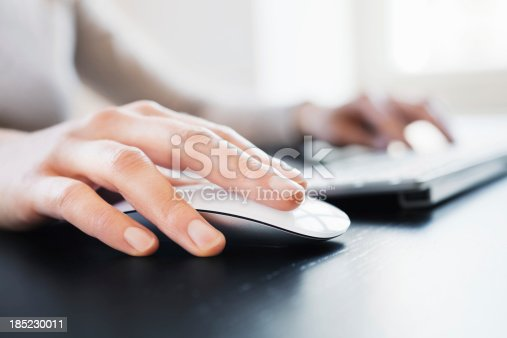 Close-up of female hand with computer mouse. Shallow DOF.