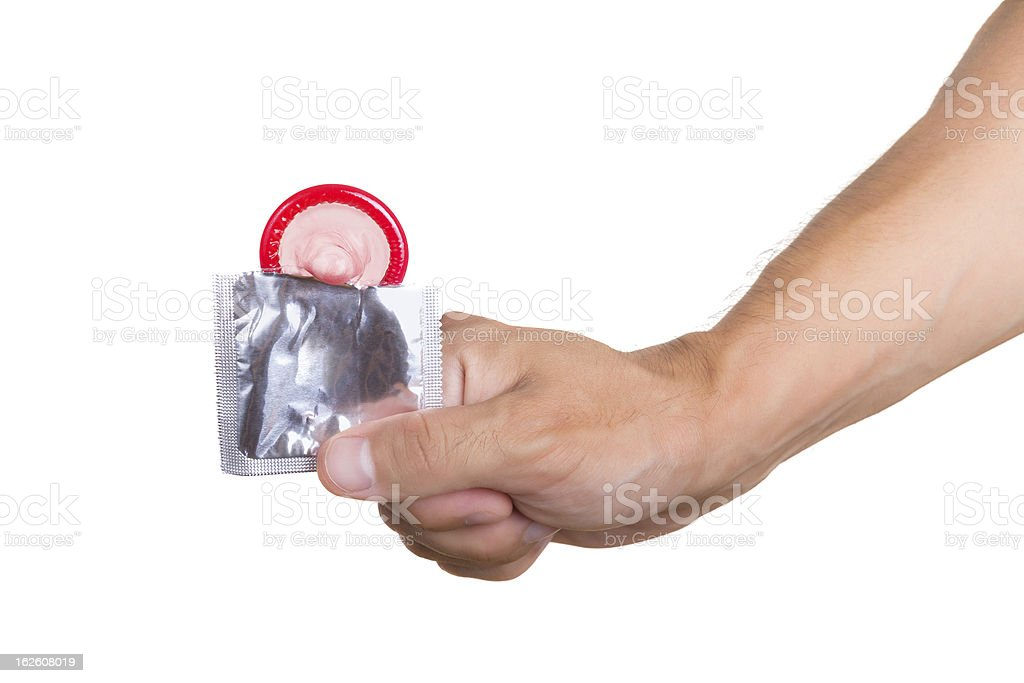 Hand with condom isolated on white royalty-free stock photo