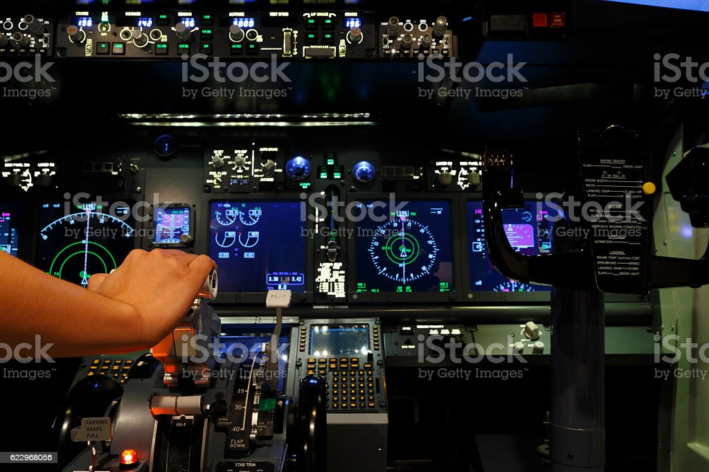 Hand with controller in cockpit of flight simulator stock photo