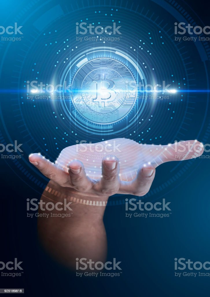 Hand With Cryptocurrency Hologram stock photo